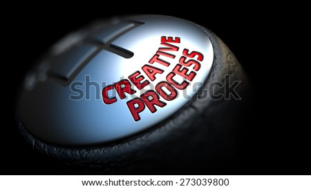 Creative Process - Red Text on Car's Shift Knob on Black Background. Close Up View. Selective Focus. - stock photo