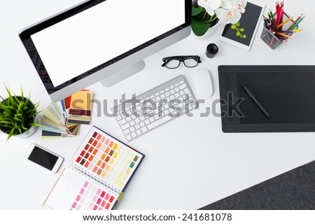 Creative professional designer's desk from above - stock photo