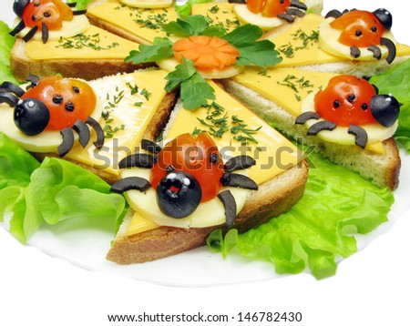 creative sandwich with cheese and lady bugs made of tomato - stock photo