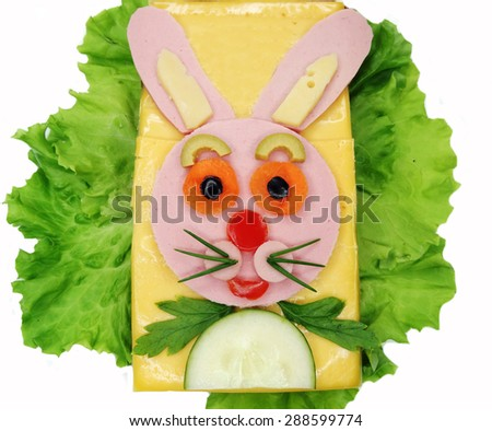 creative sandwich with cheese and salami hare form - stock photo