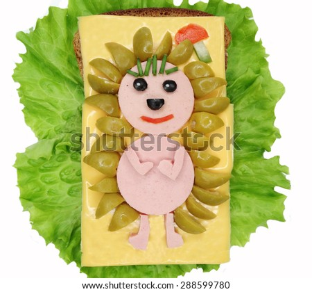 creative sandwich with cheese and salami hedgehog form - stock photo