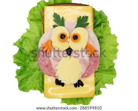 creative sandwich with cheese and salami owl bird - stock photo