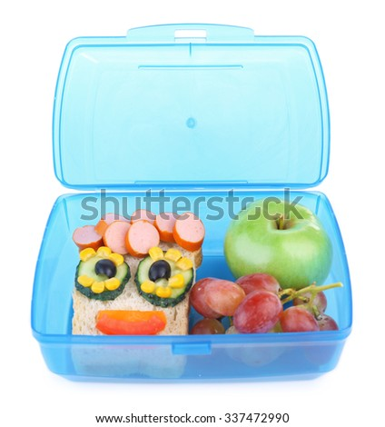 Creative sandwich with grape and apple in lunchbox isolated on white background - stock photo