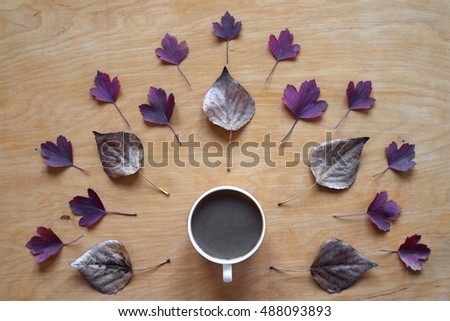 Creative shot of coffee and autumn leaves