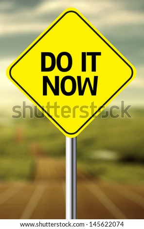 Creative sign with the message - Do It Now - stock photo