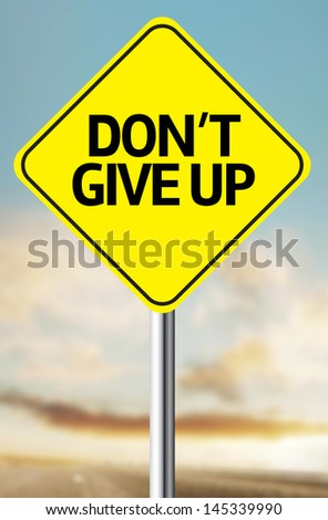 Creative sign with the message - Don't Give Up - stock photo