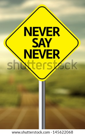 Creative sign with the message - Never Say Never - stock photo
