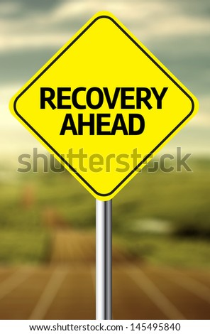 Creative sign with the message - Recovery Ahead - stock photo