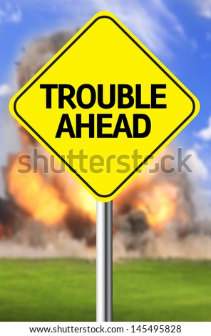 Creative sign with the message - Trouble Ahead - stock photo