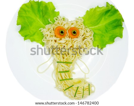 creative spaghetti food garnish with elephant shape - stock photo