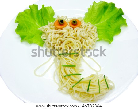 creative spaghetti food garnish with sausage elephant shape - stock photo