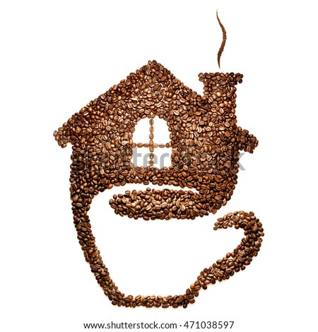 Creative still life of a cup with house image made of coffee beans, isolated on white.