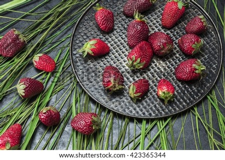 Creative strawberries laid out in the iron bowl - stock photo