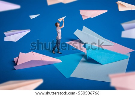 Creative Surrealism Design With Origami Paper Planes Young Girl Let Airplanes Blue