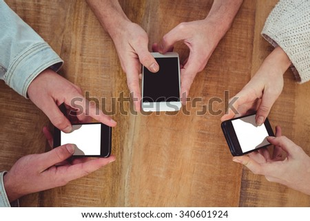 Creative team all using smartphones in casual office