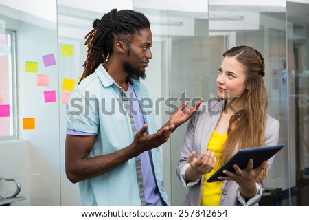 Creative team using digital tablet in the office - stock photo