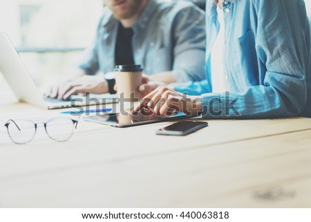 Creative team Work process modern design Studio Loft.Art director working with new freelance business startup,Using Tablet.Electronic Devices wood table. Horizontal. Film effect. Blurred background