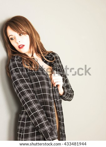 Creative Toned Portrait of a Young Caucasian Woman Hiding and looking Frightened or Scared - stock photo