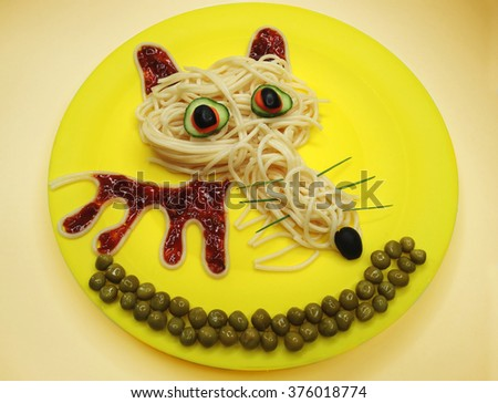creative vegetable food meal with spaghetti wolf form - stock photo