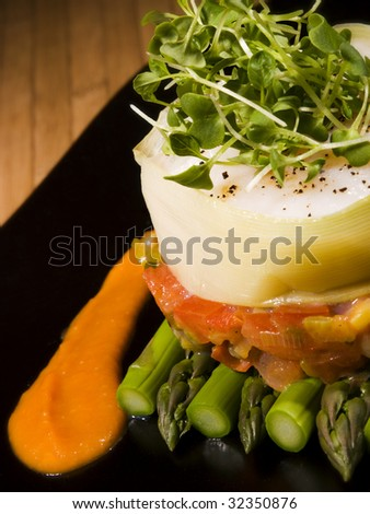 creative vegetable food with asparagus on black plate