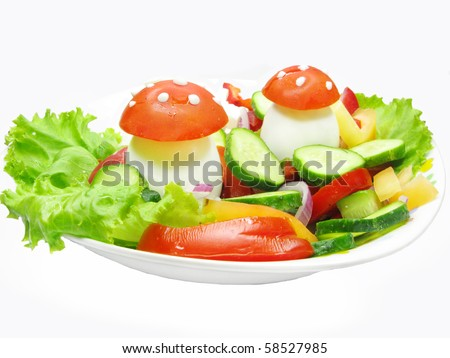 creative vegetable salad with mushrooms made of egg and tomato