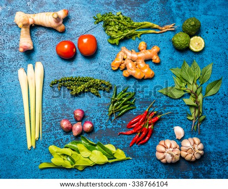Creative vegetarian cooking at home concept with fresh healthy vegetables and good herbs  on wood vintage background - stock photo