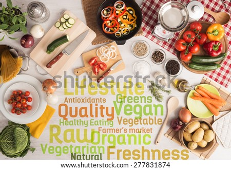Creative vegetarian cooking with food ingredients, fresh vegetables, kitchen utensils and text concepts - stock photo