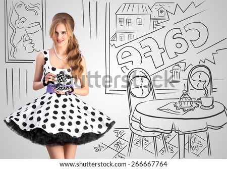 Creative vintage photo of a beautiful pin-up girl in a polka-dot dress in a cafe, holding a cup of tea on sketchy interior background. - stock photo