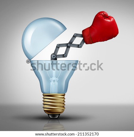 Creative weapon symbol and game changer business concept for the power of ideas and fighting to pitch powerful innovation as a  boxing glove emerging out of an open light bulb icon of creativity - stock photo