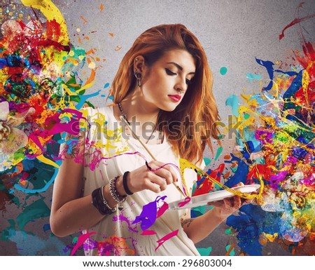 Creative woman painter with brush and palette - stock photo