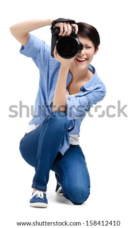 Creative woman-photographer takes photos, isolated on white - stock photo