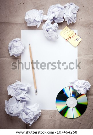 Creative work background with crumpled up paper, office objects and room for text - stock photo