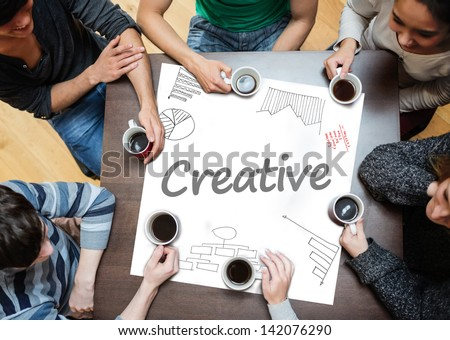 Creative written on a poster with drawings of charts during a brainstorm - stock photo