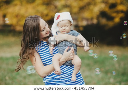 creative  young mother poses for photographer