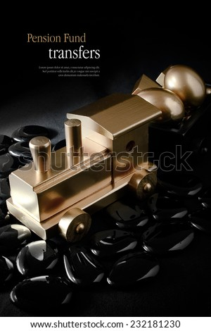 Creatively lit concept image for pension transfers. Gold wooden train with gold eggs against black. Copy space. - stock photo