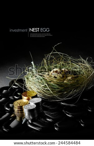 Creatively lit genuine quails eggs in a grass nest against a dark background with stacked coins. Concept image for pension or financial investments. Copy space. - stock photo
