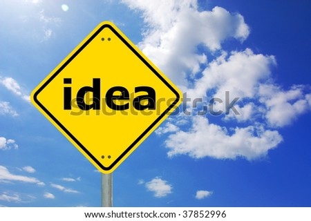 creativity and idea concept with yellow road sign
