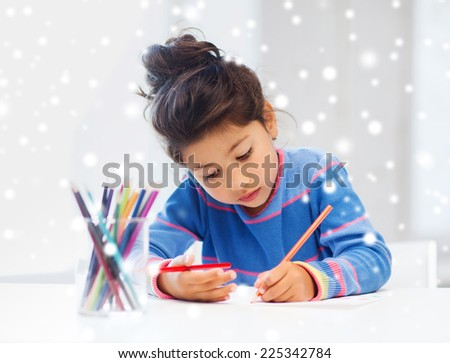 creativity, childhood and people concept - little girl with pencils drawing at home - stock photo