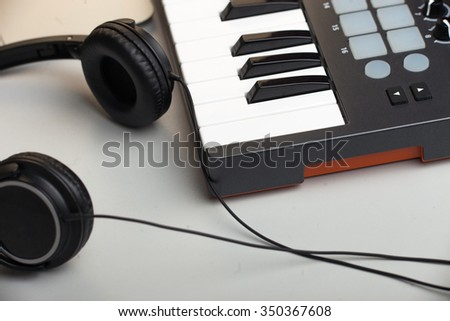 creativity.headphones and keyboard. production of electronic music. - stock photo