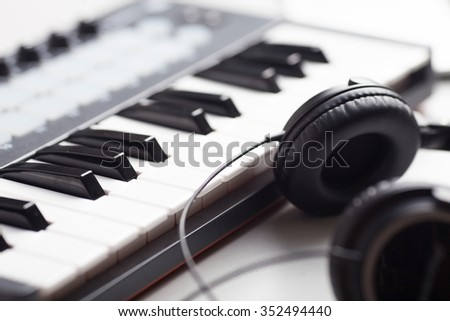 creativity. headphones and keyboard. production of electronic music. Piano keyboard with headphones for music - stock photo