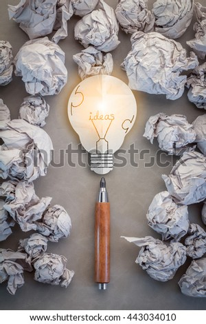 CREATIVITY IDEAS CONCEPT WITH BULB PAPER AND WOODEN PENCIL WITH TRASH PAPER BACKGROUND - stock photo