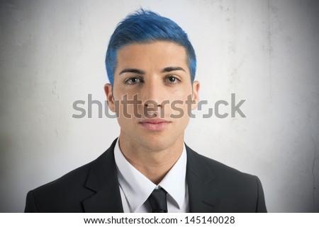 Creativity of a businessman with blue hair - stock photo