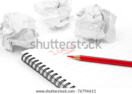 Creativity problems. Blank sheet of paper, red pencil, word Ideas and crumpled paper wads