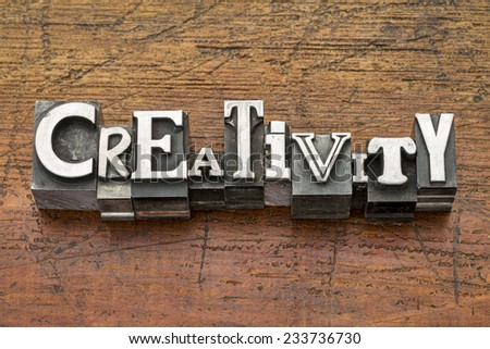 creativity word in mixed vintage metal type printing blocks over grunge wood - stock photo
