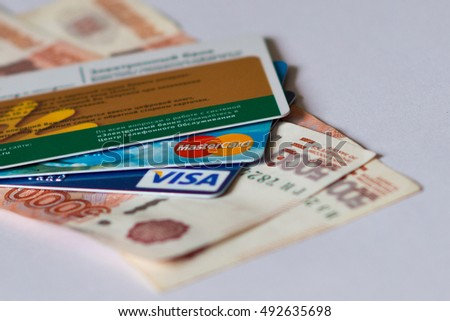 credit and debit cards of international systems Visa and MasterCard over paper banknotes of 5000 rubles. Volgograd region, October 1, 2016
