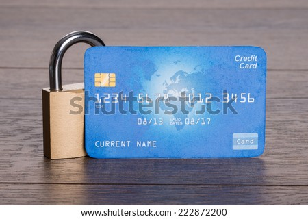 Credit card and lock in secure transactions concept - stock photo