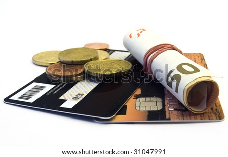 Credit card and money on white background - stock photo