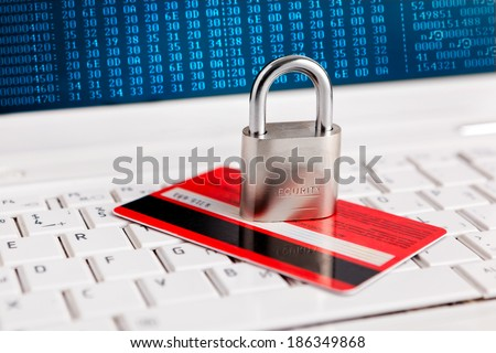 Credit Card and padlock on keyboard - security, e-commerce concept. - stock photo