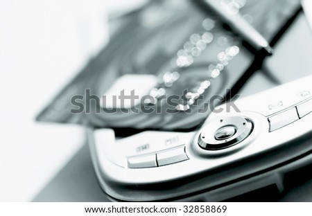 credit card and palmtop - stock photo