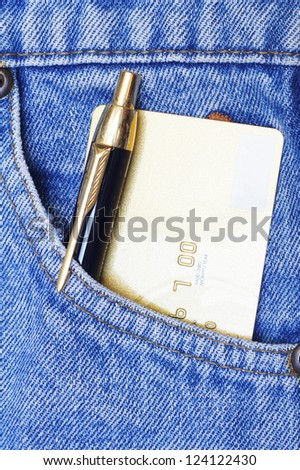credit card and pen in jeans pocket - stock photo